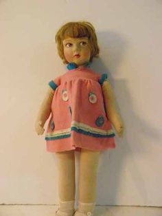 Doll manufactured by Raynal , felt and fabric stuffed, painted eyes, felt dress with matching shoes, blonde mohair wig, 1920s, 48 cm.