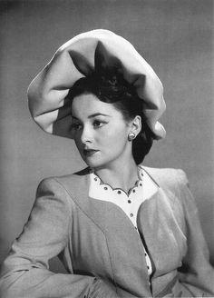 Olivia de Havilland wearing Lilly Dache