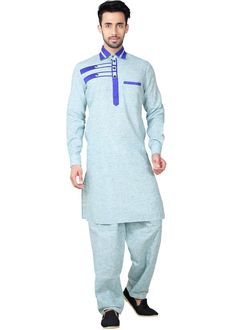 Readymade #blue full sleeved linen #kurta enhanced by patch work and button down collared neck yoke. Comes with a matching #pathani #salwar in linen.