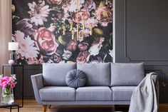 Photo about Industrial golden pendant light and black furniture in a dark living room interior with floral wallpaper and a gray couch concept. Image of apartment, flowers, industrial - 124662121 Decor, Wallpaper Living Room, Dark Living Rooms, Floral Wallpaper, Trending Decor, Interior Design, Home Decor, Room Decor, Room Wallpaper