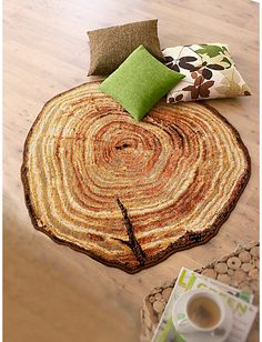 This tree stump rug is available from a company in Germany. The link takes you to a site in German for more information. It brings a rich nature inspired element to the room!