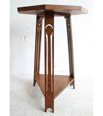 Antique Side Tables, A Liberty Arts & Crafts Occasional Table. This Arts & Crafts oak table has an octagonal top, three legs with pierced decoration and a triangular undershelf. Design Movements, Oak Table, William Morris, Liberty, Hall Tables, Arts And Crafts, Woodworking, Traditional, Antiques