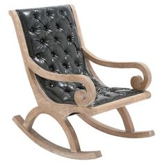 Add handsome appeal to your living room or home office with this leather-upholstered rocking chair, featuring scrolling arms and button tufting....