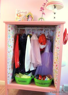 Dresser up-cycle into a fabulous dress up wardrobe. There are even flower hooks on the sides for hanging up accessories like hats and costume jewelry!