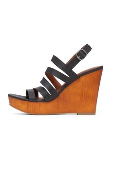 """Slim asymmetrical straps enhance this sandal set atop a faux wood wedge and platform. Adjustable slingback strap with a buckle closure. Pair with sleek separates and a simple clutch for a minimalist yet modern look. Feels like a 3"""" wedge when worn.  Measures: 4"""" Wedge Heel; 1"""" Platform  Larinaa Wedge Sandal by Lucky Brand. Shoes - Wedges Wisconsin"""