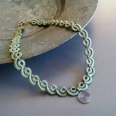 Khaki tatted lace necklace with brass round spiral charm//lace