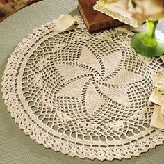 """Picturesque Pinwheel Doily Thread Crochet ePattern - a picturesque doily. The catching center resembles a toy pinwheel spinning in the wind. Our design is crocheted using bedspread weight cotton thread (size 10) and a size 7 (1.65 mm) steel crochet hook. Number of Designs: 1 Approximate Design Size: 13"""" diameter"""