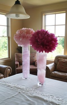 pom-poms in vases with tulle