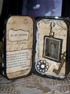 Ode to Mother in a Rusted Tin Box Assemblage    Made of a rusted hinged tin box, soldered tintype, rhinestone button, old key, vintage lace and many other found objects.