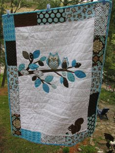 Another one of my original Owl designed quilts....in a very popular baby boy's colour scheme with some Joel Dewberry and Riley Blake fabrics---It's entirely backed in Owl print flannel.  Look up Barabooboo on Etsy if you want to order a custom made one in YOUR colour scheme.