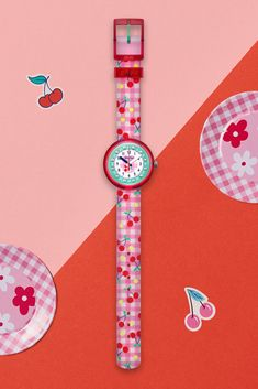 An online exclusive, this pink and white checkered textile watch for kids has a design inspired by cherries for a fun and fruity look. The CHERRIFIC (ZFPNP057) has a machine-washable strap, and gemstones on the digital printed dial that make learning to tell the time fun! A great gift for children's birthdays, this Swiss-made watch also has a transparent plastic case that is BPA- free and resistant to water. Gifts For Kids, Great Gifts, Swiss Made Watches, Telling Time, Cherries, Plastic Case, Swatch, Birthdays, Gemstones
