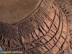 SILK DRAWN BONNET, 1825-1835 April 2009 Vintage Fashion and Textile Auction New York City Chocolate brown silk taffeta, stiffened buckram crown w/ 7 brim, 4 bavolet edged w/ 4 rows of cording, original chin ties, Crown-Brim Depth 12.25, Ht 14.25