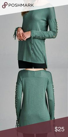 Lace Up Sleeve Top Description: Lace up long sleeve top with grommets. Slight back yoke, semi-loose fit and wide scoop neckline, hits mid thigh. | Made in: USA Tops