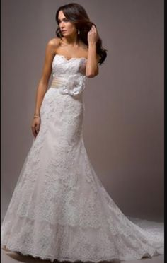 """The gown was made to order 5"""" shorter than the usual length (I'm 5'). I wore 3"""" heels day of wedding and the length was perfect. I also had the back made into a zip closure instead of using the corset"""