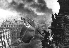 Raising the Hammer and Sickle over the Reichstag,   2 May, 1945 by Yevgeni Khaldey