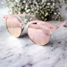 rose gold sunglasses.
