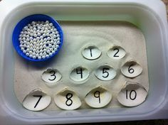 For younger ones use small shells instead of pearls: Ocean Unit - clam shells, sand and pearls. Ideal numbers learning, transferring pearls to shells in sand. The added sensory makes this a perfect option. Montessori Math, Preschool Classroom, Kindergarten Math, Kids Math, Future Classroom, Classroom Themes, Reggio Emilia, Ocean Activities, Preschool Activities