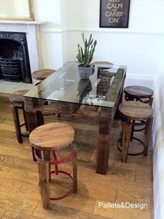 Pallet kitchen table with glass top. Great to be used as a craft scrapbooking table too. I could generate some seriously good ideas sitting at this rustic beauty! Wooden Pallet Furniture, Wooden Pallets, Home Furniture, Modern Furniture, Pallet Wood, Pallet Dining Table, Dining Room Table, Pallet Tables, Table Stools