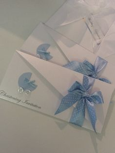 Christening Invitations - fold card into thirds - cut one third on angle. Tie with ?? Lace information on inside card.