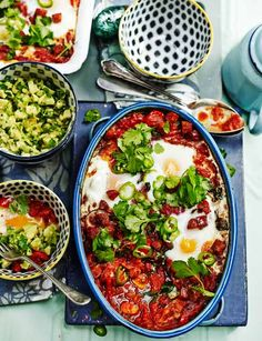 This fiery one-pot dish works perfectly as a hearty weekend brunch. baked spicy Mexican eggs and chunky guacamole (gluten-free)! Spicy Recipes, Mexican Food Recipes, Vegetarian Recipes, Cooking Recipes, Healthy Recipes, Egg Recipes, Cooking Tips, Brunch Dishes, Brunch Recipes