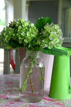 my pink and green hydrangeas mason jar makes a cute simple centerpiece can also do blue and white or just white. Orlando wedding flowers | www.weddingsbycarlyanes.com