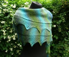 """""""A lace shawl very easy, perfect for beginners. You can add beads to give a nice light touch. You can knit it with all types of yarn: solid, degraded or fancy, everything is possible.""""<br /> <br /> <strong>Scroll to the bottom of the blog post in order to access the English version of this pattern.</strong>"""