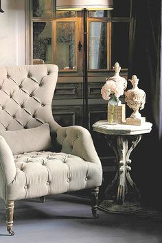 Such a great chair and I love the little table arrangement.