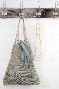 Handcrafted by traditional macrame artisans in Bangladeshand finished with leather handles Fair Trade, natural and handmade.
