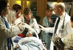 "ER - Season 14 premiere, ""The War Comes Home"" - Maura Tierney as Abby, Linda Cadellini as Samantha, Stanley Tucci as Dr. MorrettiPhoto by: Scott Garfield Great Tv Shows, Couple Photos, Stanley Tucci, Celebs, News, Room, Pictures, Cumin Plant, Tights"