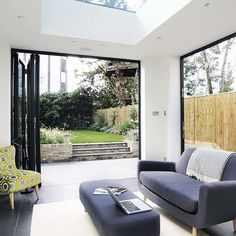 Modern living room with bi-fold doors | Living room decorating | Beautiful Kitchens | Housetohome.co.uk