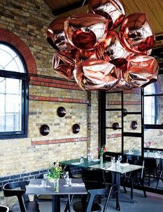The Dock Kitchen, London by Tom Dixon - copper shades