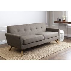 This gorgeous sofa is trendy and contemporary combining comfort with design. Made with high density foam cushioning, it is functional and fashionable.