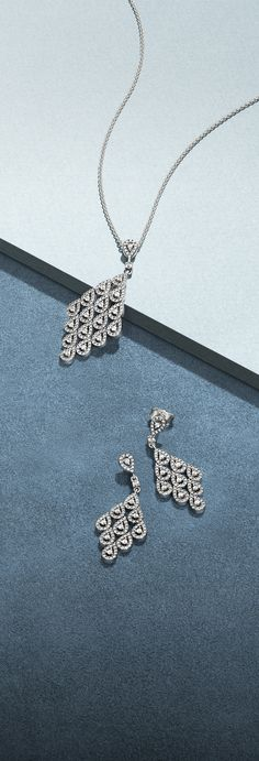 Glistening cubic zirconia stones adorn teardrop shapes, delicately cascading down this statement necklace. For optimum sparkle, wear the necklace with the matching earrings.