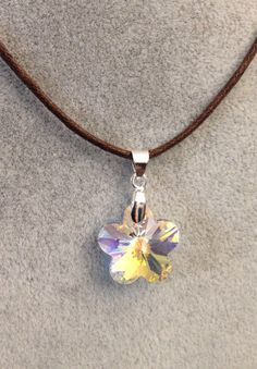 Swarovski Crystal Flower Pendant With Brown Cord by meldiddesigns