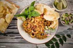 Stock Photo : Directly Above Shot Of Prawns Noodles With Chips Served In Plate At Wooden Table Prawn, Wooden Tables, Pulled Pork, Noodles, Chips, Plates, Ethnic Recipes, Food, Wood Tables
