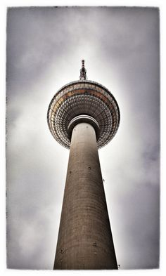 View from below… #Berlin Fernsehturm Tower. Also know locally as the Pope's Revenge cause when the sun hits the tiled stainless steel dome, it usually creates a reflection in the form of a crucifix.      (#STMT X Germany Sourcing Trip – photo #RAH)