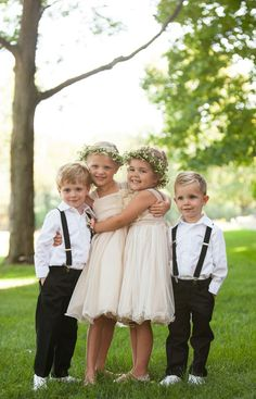Flower girls with flower crowns and ring bearers with suspenders | Erin Johnson Photography | www.theknot.com