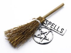 Photo about A magical witches broom, pentacle talisman, and silver banner printed with spells. Image of pagan, spell, amulet - 13814906 Pentacle, Bali, Bedknobs And Broomsticks, Magical Pictures, Witch Broom, Stock Image, Ancient Symbols, Cauldron, Pagan