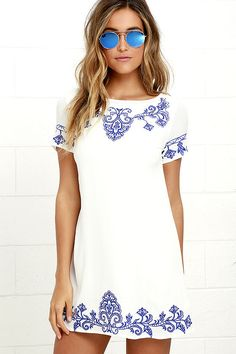 Fables about the Tale to Tell Blue and Ivory Embroidered Shift Dress are sure to follow its arrival! Swirling blue embroidery decorates woven poly as it shapes a rounded neckline, short sleeves, and a darted, shift bodice. Exposed gunmetal back zipper.
