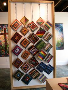 Display of small, quilted pieces.