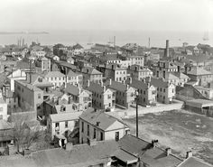 Shorpy print, circa 1910. Posted on Facebook by Henry Horres Jr. Over the Charleston rooftops toward East Bay Street. Smokestack was from a cotton press on Longitude Lane. Pic probably taken from St. Michael's steeple.