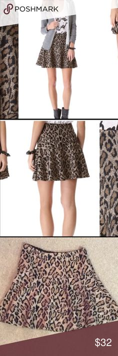 """Free People Leopard Print Skater Skirt Sz 2 A-line brown/black fit n flare skater skirt, with side zipper.   Waist:  approx 13"""" across when flat. Length:  approx 16"""" I included 2 stock photos for reference.   Thanks so much for looking.  Please let me know if you have any questions. Reasonable offers are always considered.  Add this item to a bundle and receive a private discount. Free People Skirts Circle & Skater"""