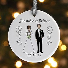Too cute!!! These Personalized Christmas Ornaments with Bride and Groom Characters are a cute way to remember your wedding date ... what a cute wedding gift idea! You actually get to customize the characters' hair color and skin complexions plus you can choose the color of the bride's dress and the groom's vest & tie! Great way to get a new couple started on their own collection and it's only $12.95! #Wedding