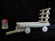 Workin' the fields with a Wooden Toy Hay Wagon! Especially fun if a family member currently uses a real one. Hooks up to our Wood Toy Tractor or Pickup Truck.