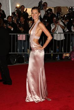 Pin for Later: 50+ Iconic Met Gala Dresses Worn by Latinas Gisele Bündchen For the Superheroes: Fashion and Fantasy gala in 2008, the Brazilian beauty wore a barely there Versace piece.