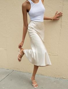 Add our classic beige satin silky long skirt to your collection of fashion essentials. Find long skirts, midi skirts, mini skirts, & much more at Pixie Market. Mode Outfits, Stylish Outfits, Dress Outfits, Fashion Outfits, Midi Dress Outfit, Zara Outfit, All White Outfit, Neutral Outfit, Classic Outfits