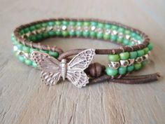 "Butterfly leather wrap bracelet, ""Fly- Sea Green"" green, silver, signed butterfly button, distressed leather, country boho chic. $50.00, via Etsy."