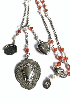 Rosary style necklace with vintage silver charms....