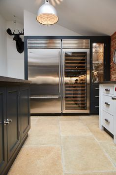 Large full height stainless steel Wolf wine fridge and fridge freezer next to bespoke painted cabinets - The Main Company Kitchen Room Design, Modern Kitchen Design, Home Decor Kitchen, Kitchen Interior, Living Room Kitchen, Bespoke Kitchens, Luxury Kitchens, Home Kitchens, Kitchen Upgrades