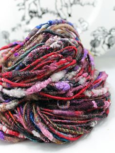 This one of a kind, art yarn was corespun from an amazing batt that was hand dyed and carded by Hobbledehoy, here on Etsy. Contents: merino,